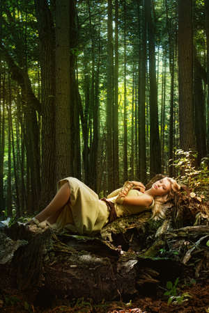 girl in the forest: Blond girl in a magic forest Stock Photo