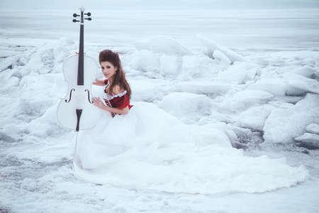 cello: Beautiful brunette in a dress