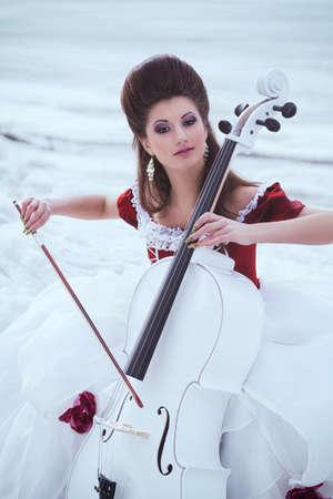 Beautiful brunette in a dress photo
