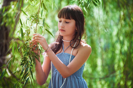 osier: Girl staying near a osier