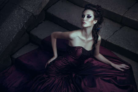 evening gowns: Beautiful woman in violet dress