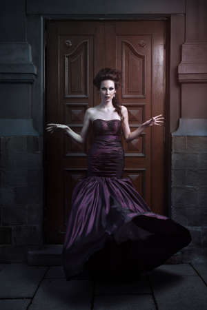 Beautiful woman in violet dress photo