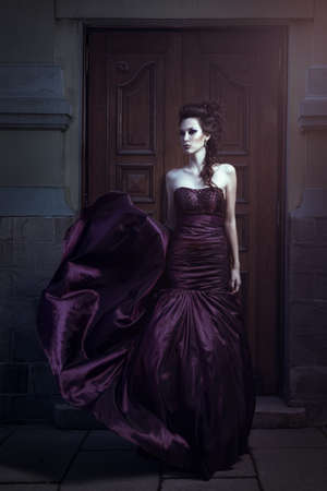 evening gown: Beautiful woman in violet dress
