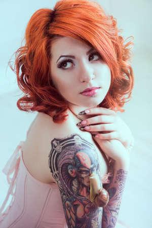 tattoo face: Sensual redhead woman