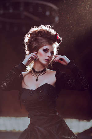 victorian girl: Mysterious woman dressed in gothic dress posing in ruined building
