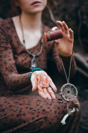 sibyl: Beautiful young woman in the forest holding a candle dreamcatcher