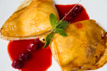 Pancakes with cottage cheese and berry sauce photo