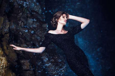 waterfall in the city: Woman posing near waterfall
