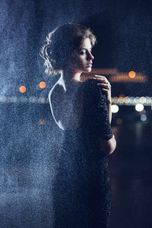girl in rain: Woman posing in the rain