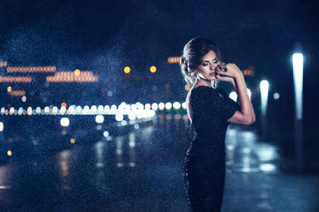 Woman posing in the rain  photo