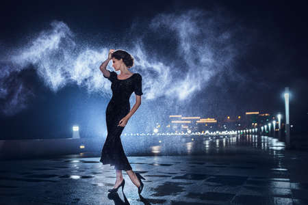 mysterious woman: Woman posing in the rain