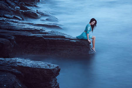 wet dress: Beautiful young woman on sea Stock Photo