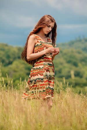 Woman walking in field photo