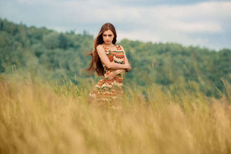 red haired girl: Woman walking in field