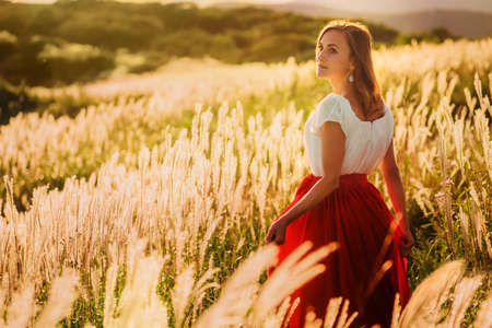 brown haired girl: Girl at sunset Stock Photo