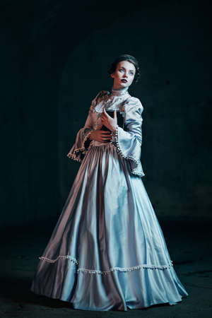 white dresses: Woman in victorian dress
