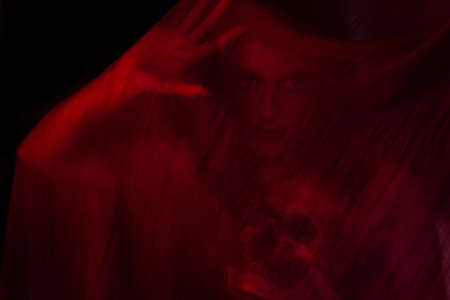annihilation: Girl posing with red fabric