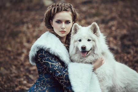 queen blue: The woman on winter walk with a dog