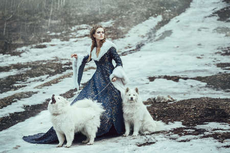 The woman on winter walk with a dog