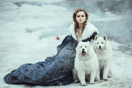 princess dress: The woman on winter walk with a dog