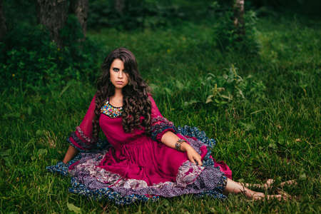 gypsies: Portrait of a beautiful girl gypsy in violet dress Stock Photo