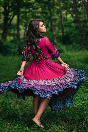 gipsy: Portrait of a beautiful girl gypsy in violet dress Stock Photo