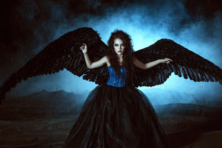 fallen angel: Pretty girl-demon with black wings behind her back