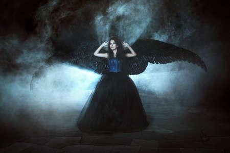 dark angel: Pretty girl-demon with black wings behind her back