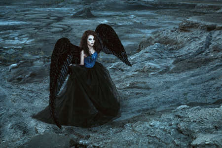 gothic angel: Pretty girl-demon with black wings behind her back