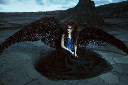 fallen angel: Pretty girl-demon with black wings behind her back