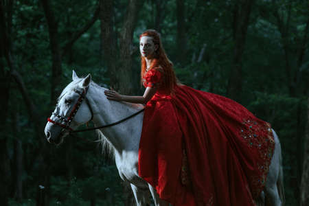 Princess in red dress with horse in forest