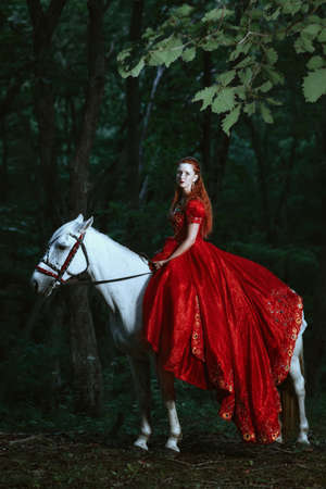 'dark ages': Princess in red dress with horse in forest