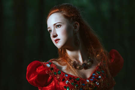 red horse: Princess in red dress dress with horse in forest