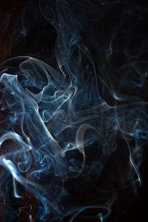 otherworldly: Abstract white smoke on black background. Close-up