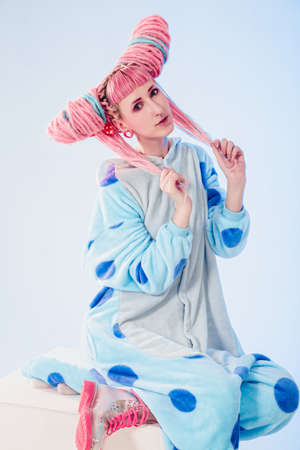 pj's: Funny girl in blue pajamas on white background