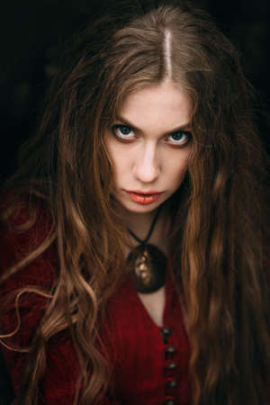 gothic woman: Beautiful witch who lives in the woods Stock Photo