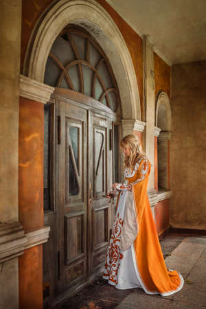 medieval dress: Beautiful lady with blond hairs in medieval dress