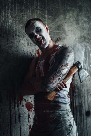 maniacal: Crazy clown holding an ax in his hands