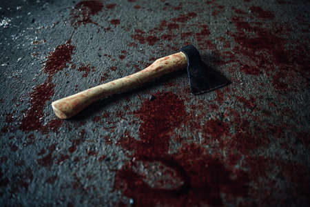maniacal: Bloody axe of maniac lying on the floor Stock Photo