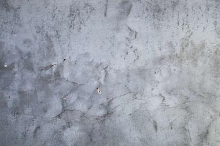 Pintura agrietada en la pared