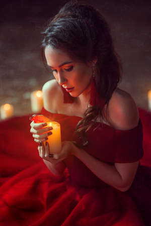 adivino: Beautiful lady with candles Foto de archivo