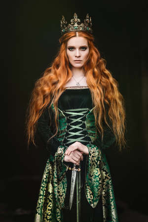 Woman in green medieval dress 스톡 콘텐츠