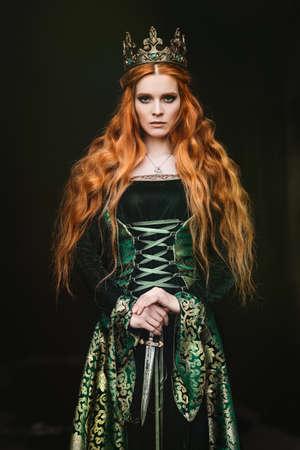 Woman in green medieval dress Foto de archivo