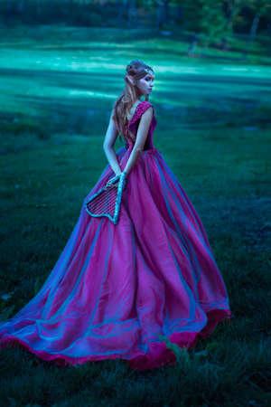 Elf woman in violet dress Banque d'images