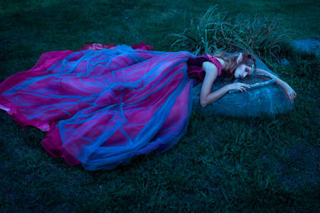 Elf woman in violet dress Stock Photo