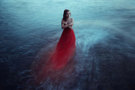 Lonely woman near the sea Reklamní fotografie