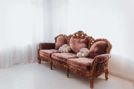 Brown sofa in white interior Stock Photo