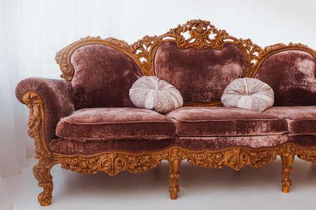 Brown sofa in white interior 스톡 콘텐츠