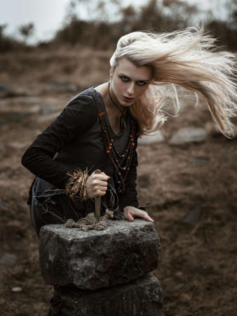 Witch in a long black dress Stock Photo - 97600766