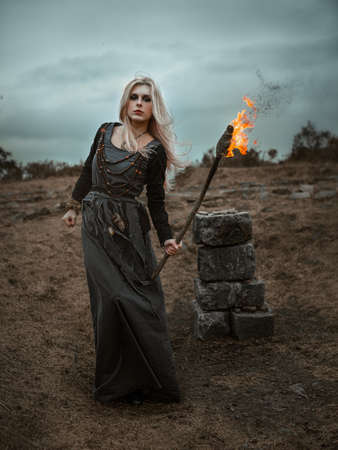 Witch in a long black dress